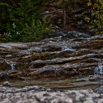 Water passing over multiple layers of rock creates and nice abstract play of nature.