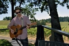 Musician Jon Ransom play guitar on the deck at the Vista Hills Vineyard, Yamhill County, Oregon
