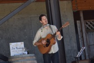 Jon Ransom plays on patio at Vista Hills Vineyard Treehouse, guitar, musician, live, music, playing,
